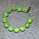 green skulls bracelet